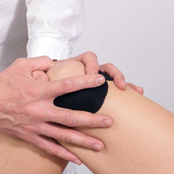 articulația genunchiului umflat decât a trata lumânări pentru durere în articulații și mușchi